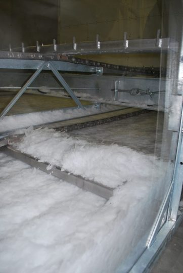 Piles of ice inside the ice machine.