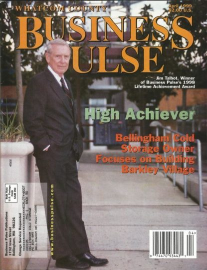 Jim Talbot poses for a cover photo outdoors on the cover of Business Pulse Magazine.