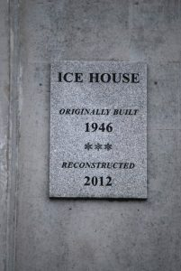 Plaque honoring the reconstruction of the BCS ice house in 2012.