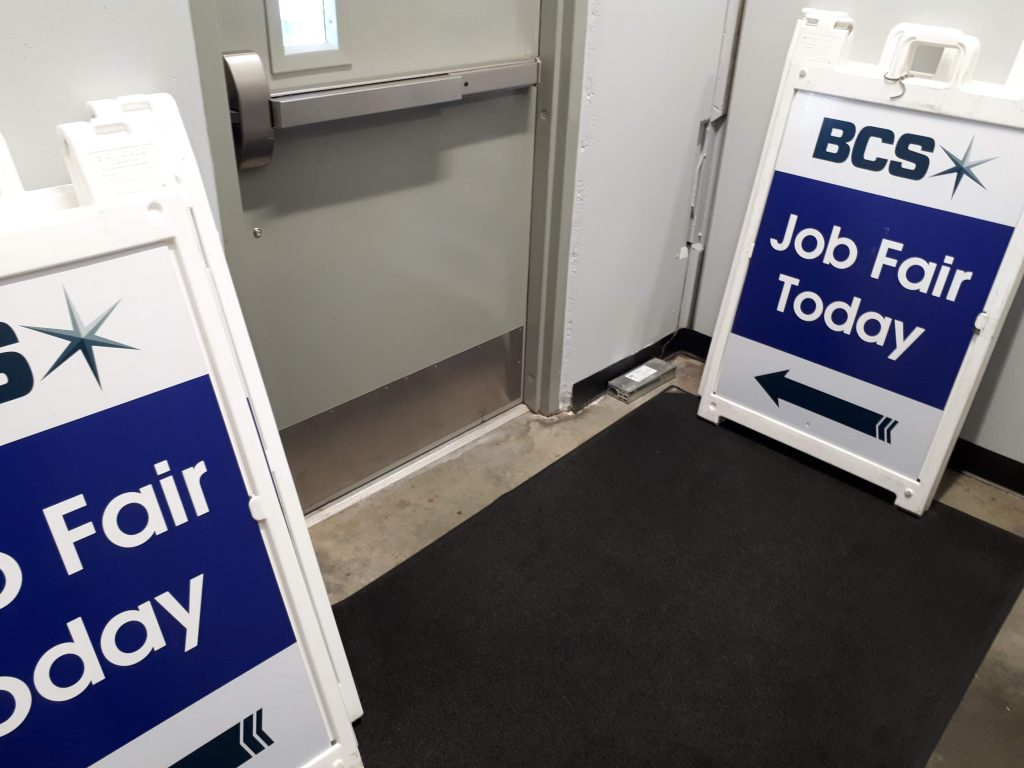 Signs say 'Job Fair Here Today.'