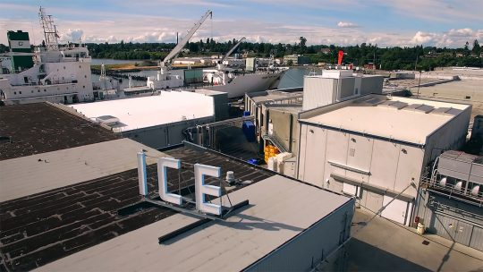 Aerial image shows large 'ICE' sign atop a building at Bellingham Cold Storage.