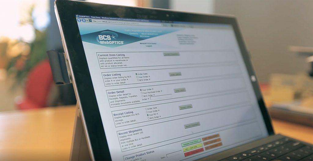 Laptop screen showing the WebOPTICS interface.
